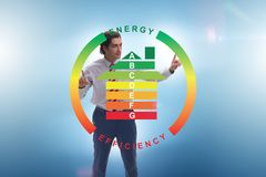 The businessman in energy efficiency concept. Businessman in energy efficiency concept royalty free stock photo