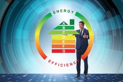 The businessman in energy efficiency concept. Businessman in energy efficiency concept royalty free stock image
