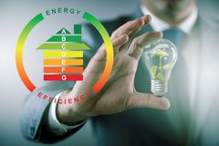 The businessman in energy efficiency concept. Businessman in energy efficiency concept stock photography