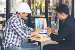 Businessman and Engineer discussing some project, choose colors. And materials for interior design new project stock photo
