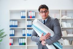 The businessman engineer draftsman with blueprints drawings Royalty Free Stock Photo