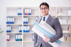 The businessman engineer draftsman with blueprints drawings Royalty Free Stock Photography