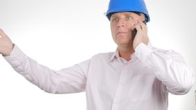 Businessman Engineer Talk to Mobile Gesturing Furious Receive Bad News stock photo