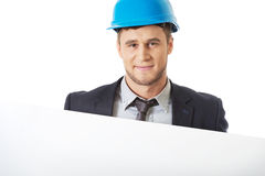Businessman enginner holding empty banner. Stock Photo