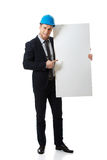 Businessman enginner showing empty banner. Stock Image