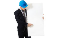 Businessman enginner showing empty banner. Stock Image