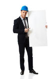 Businessman enginner showing empty banner. Royalty Free Stock Photos