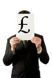 Businessman with English pound. Businessman is holding a English pound sign royalty free stock photography