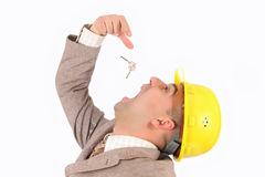 A businessman engulf keys Stock Images