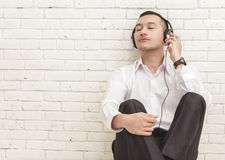 Businessman enjoy listening music using headphones Stock Photos