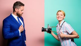 Businessman enjoy star moment. Photographer taking photo successful businessman. Paparazzi concept. Photosession for stock image
