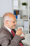 Businessman enjoying a cup of coffee Royalty Free Stock Photography