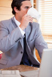 Businessman enjoying a cup of coffee in the kitchen Stock Photography