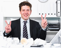Businessman enjoying the excellent results Stock Photos