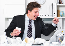 Businessman enjoying the excellent results Royalty Free Stock Photo