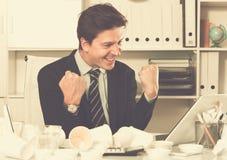 Businessman enjoying excellent results Stock Image