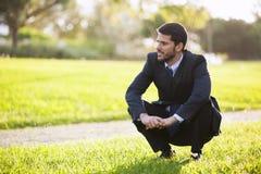Businessman enjoying the grass smell Stock Photos