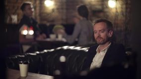 Businessman enjoying his coffee break in cafe stock footage