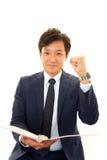 Businessman enjoying success Stock Photos