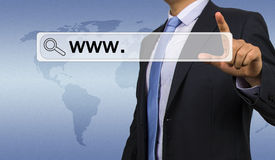 Businessman entering web address. Concept Stock Photo