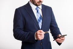 Businessman enters credit card information into black phone stock photos