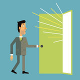Businessman enters the open door from which light pours. Royalty Free Stock Images