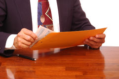 Businessman with Envelope and Forms Royalty Free Stock Images