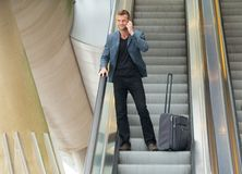 Businessman on Escalator Stock Photography
