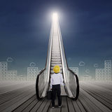 Businessman at escalator with cityscape Royalty Free Stock Image