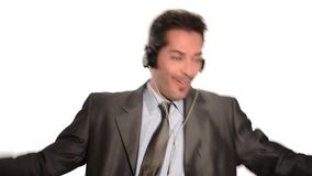 Businessman escapes stress listening to music stock video