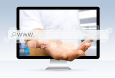 Businessman escaping from computer holding digital web bar in hi Stock Images