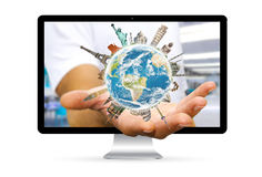 Businessman escaping from computer with planet earth and landmar Stock Images