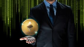 Businessman with ethereum coin over binary code. Cryptocurrency, financial technology and business concept - close up of businessman with golden ethereum coin Royalty Free Stock Photos