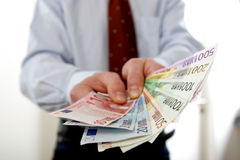Businessman with Euro bills Royalty Free Stock Photo