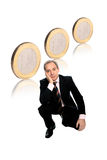 Businessman with euro coins. Relaxed Businessman with euro coins isolated over white background stock images