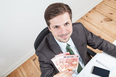 Businessman with 30 euro Royalty Free Stock Photography