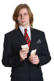 Businessman with Euro money. Handsome young businessman with long hair holding European money, isolated on white background Royalty Free Stock Photo