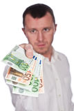 Businessman with Euros. In hand isolated on white Royalty Free Stock Photography