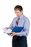 Businessman examining documents Royalty Free Stock Images