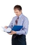 Businessman examining documents Royalty Free Stock Images