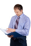 Businessman examining documents Royalty Free Stock Photos
