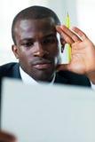 Businessman examining documents Stock Image