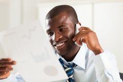 Businessman examining documents Stock Photography