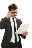 Businessman examining papers Stock Photography