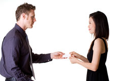 Businessman Exchanging Name Cards With Woman Stock Image
