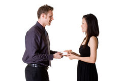 Businessman exchanging name cards with woman. Businessman in formal suit and woman in dress exchanging business card Stock Images