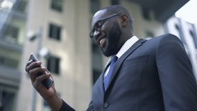 Businessman excited with convenient app in smartphone, electronic organizer stock footage
