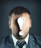 Businessman with exclamatory mark. Portrait of faceless businessman with exclamatory mark Stock Photography