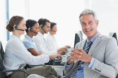 Businessman with executives using computers Royalty Free Stock Images