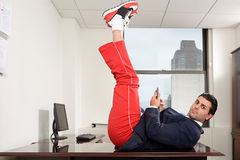 Businessman exercising in office royalty free stock photos